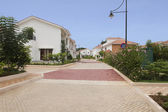 Tiled road and bungalows — Stock Photo