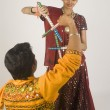 Couple performing dandiya — Stock Photo