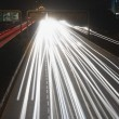 Streaks of headlights of moving vehicles on road — Stock Photo #33105177