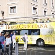 Tourists near a tour bus Roma Cristiana — Stock Photo #33108611