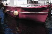 Boat at a harbor — Stock Photo