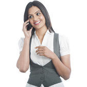 Businesswoman talking on a mobile phone — Stock Photo