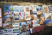 Paintings for sale at a market stall — Stock Photo