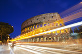 Night traffic in front of Colosseum — Stock Photo