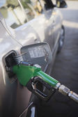 Car being refueled at a gas station — Stock Photo