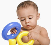 Baby boy playing with toys — Stock Photo
