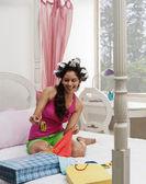 Woman choosing cloths and bangles — Stock Photo