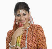 Woman holding a Dandiya at Navratri — Stockfoto