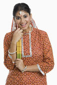 Woman holding a Dandiya at Navratri — Stock Photo