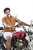 Man riding a motorcycle — Stock Photo