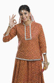 Woman holding a Dandiya at Navratri and making ok sign — Stock Photo