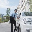 Stock Photo: Businessmstanding beside car at roadside