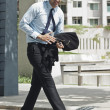 Businessman walking on the road — Stock Photo