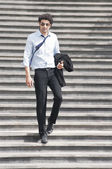 Businessman moving down on steps — Stock Photo