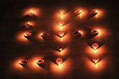 Swastika made from oil lamps — Stock Photo