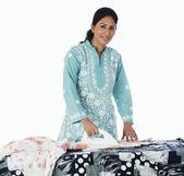 Woman ironing cloths — Stock Photo