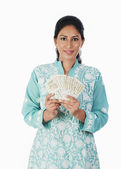 Woman holding Indian paper currency — Stock Photo