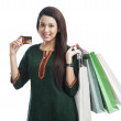 Woman holding shopping bags and credit card — Stock Photo #33139881