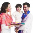 Stock Photo: Family celebrating Holi festival