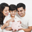 Family with a piggy bank — Stock Photo