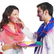 Stock Photo: Couple celebrating Holi festival