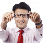 Businessman holding eyeglasses — Stock Photo #33137013