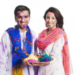Stock Photo: Couple celebrating Holi with Holi colors