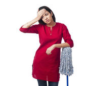 Woman leaning on a mop — Stock Photo