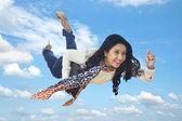 Businesswoman flying — Stock Photo