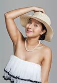 Woman in white hat posing — Stok fotoğraf