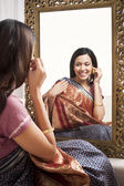Reflection of a woman in mirror — Stock Photo