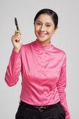 Businesswoman showing a pen — Stock Photo