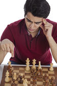 Man playing chess — Stock Photo