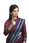 Indian woman pointing — Stock Photo