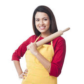 Woman holding a rolling pin — Stock Photo
