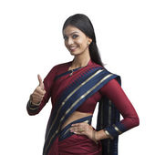 Indian woman gesturing thumbs up sign — Stock Photo