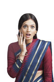 Traditionally Indian woman looking surprised — Stock Photo