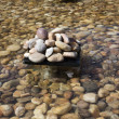 Stock Photo: Pebbles in an artificial pond