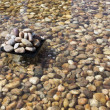 Pebbles in an artificial pond — Stock Photo