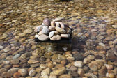 Pebbles in an artificial pond — Foto Stock