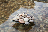 Pebbles in an artificial pond — Stockfoto