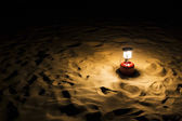 Lantern on sand dune — Stock Photo