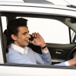 Man talking on a mobile phone while driving a car — Stock Photo