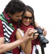 Couple holding a camera — Stock Photo #33275753