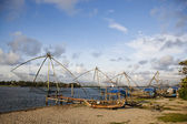 Chinese fishing nets and boats — Stock Photo