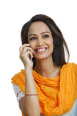Woman talking on a mobile phone — Foto de Stock
