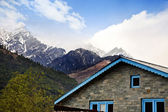 House with mountain range — Stock Photo
