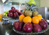 Assorted fruits on a table — Stock Photo