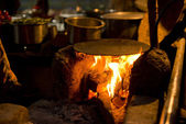 Griddle on traditional Indian stove — Stock Photo