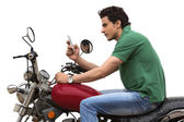 Man sitting on a motorcycle — Stock Photo